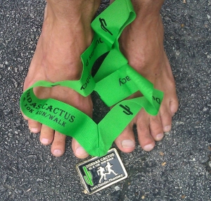 Finisher's medal, finisher's feet.